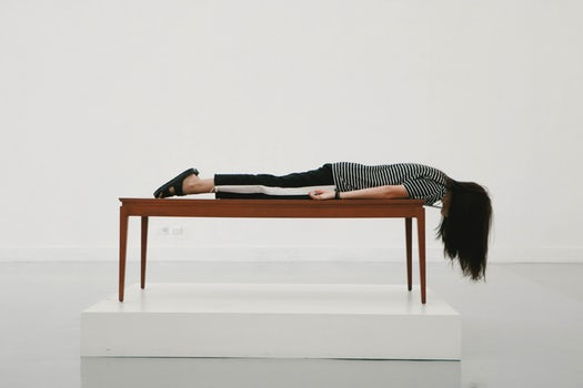 Lady laying face down on a table